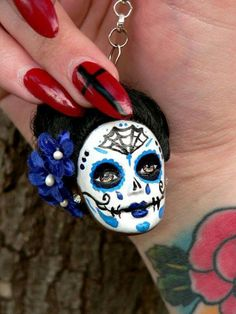 If barbie looses her head in your house, save it and make a sugar skull Keychain out of it