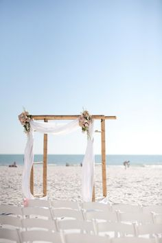 perfect for a beach wedding i would just add more colorful flowers