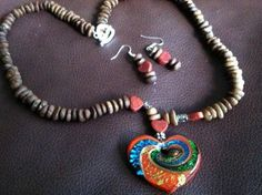 Medium / Long handmade coffee beans necklace combined with Murano crystal, coral,silver and pewter. Comes with earings