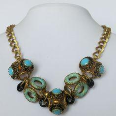 A vintage Henkel & Grosse Turquoise glass necklace.