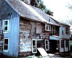 Various patch jobs had to be removed, but the vertical siding is visible on the gable end. History   Morgan Log House