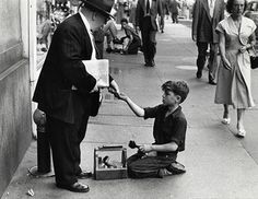 Shoeshine boy getting paid, 1948 Photograph: Ruth Orkin
