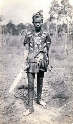 Moro (Philippines) wearing locally made mail and plate armor.
