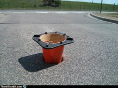 Not how we recommend repairing a pothole!