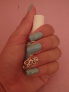 Turquoise with leopard animal print nail art design
