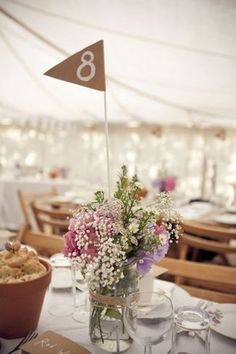 Table numbers - little flags (like the bunting except can make with card) into jars with flowers