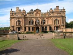 Gosford House, Longniddry, East Lothian. Family seat of the Charteris family. Recently home of the late Rt. Hon. David Charteris, 12th Earl of Wemyss; 8th Earl of March, chief of the name & arms of Charteris. Built by 7th Earl of Wemyss 1790|1800, to plans by the architect Robert Adam. The 8th Earl knocked down the wings, which his grandson, the 10th Earl, rebuilt in 1891 to designs by William Young. Built in the neoclassical style. During WWII the British Army occupied the house.