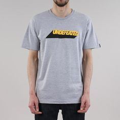 """The Cast T-shirt from Undefeated features a simple yet bold graphic screen printed across the chest in black and yellow, while a woven Undefeated label sits on the left sleeve finishing off the branding.100% cotton construction, with a regular fit and a ribbed collar for a classic look.    Our model is 6ft tall with a 38"""" chest and wears a size Medium"""