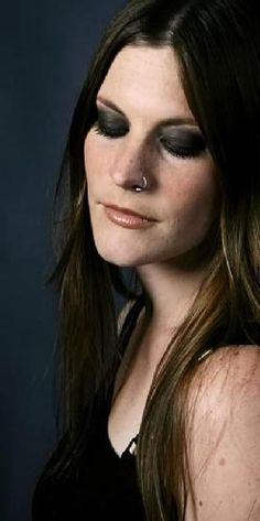 Floor Jansen - Presently fronting Nightwish and she has her own band, After Forever. She is great in both!