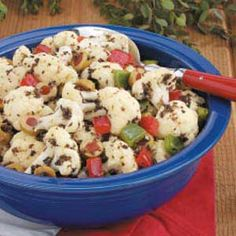 Cauliflower Olive Salad ~ This colorful toss combines cauliflower and black and green olives with sweet peppers and red onion for a satisfying blend of flavors. The lemony vinaigrette coats the salad well and gives it a pleasing tartness.
