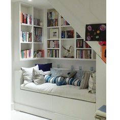 The most snug and cosy 'book nooks' to inspire the creation of your own retreat Interior , Reading Nook Ideas; Cozy Space To Relax While Enjoying A Book : Reading Nook Under Stairs With Book Collections