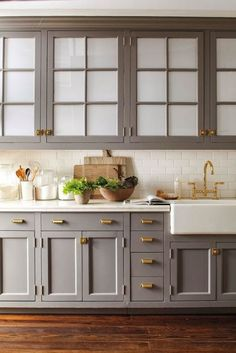 kitchen; gray cabinets; white subway tile; brass pulls