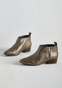 Serene Bootie. Cool as can be and calm as a glimmering lake, this bronze pair of booties by Seychelles is just what you needed to top off your shoe collection. #bronze #modcloth