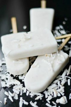 Homemade Coconut Creamy Popsicles are made with fresh shaved coconut, coconut milk and vanilla paste for a flavor burst!