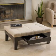 Add character to the room with this ivory storage ottoman. Designed with tapered hardwood legs to protect your floor, linen upholstery, and a hidden slide-out drawer, this contemporary ottoman will complement a variety of loveseats or sofas.