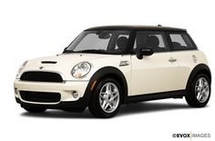 The MINI Cooper S: super sport edition of the MINI Cooper featuring hood scoop, S graphic, double exhaust pipes and chrome gas cap.