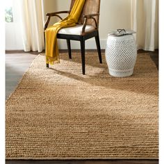<li>Complete your home decor with a hand-woven area rug</li> <li>Casual rug features rich shades of beige</li> <li>Rug is constructed of 100-percent natural jute</li>