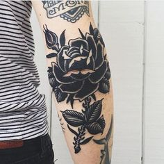 What does black rose tattoo mean? We have black rose tattoo ideas, designs, symbolism and we explain the meaning behind the tattoo. Black Rose Tattoo Meaning, Black Rose Tattoos, Black Rose Tattoo Coverup, Elbow Tattoos, Sleeve Tattoos, Rose Elbow Tattoo, Tattoo Arm, Body Art Tattoos, Cool Tattoos