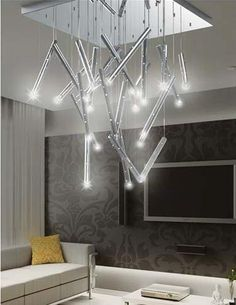 The Rain Collection of contemporary LED pendants and chandeliers is inspired by the wonderment and fluidity of falling rain. Equipped with both functional and ambient lighting via the company's new innovative LED board design. TM 3939. www.accesslighting.com