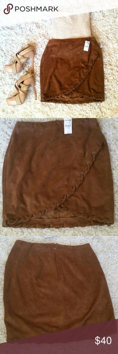 Express suede mini skirt NWT Adorable skirt from Express. Its a brown suede material with a cross over style. Also a zipper in the back. Super cute with a sparkly gold sweater and high heels or brown boots!! Express Skirts Mini
