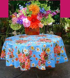 Colorful! You can buy these tablecovers at Cole hardware