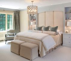 Beautiful Built-In. Architectural millwork creates a functional headboard in this elegant bedroom. Shelves flank the bed providing storage for lamps, reading materials, and personal keepsakes. We love the softness created as a headboard using vertical upholstery panels between the shelves.
