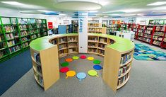 United Nations International School - DEMCO Library Interiors - love the curved reading nook