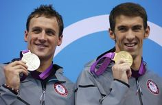 Gold medalist Michael Phelps of the U.S. (R) and silver medallist and compatriot Ryan Lochte hold their medals during the men's 200m individual medley victory ceremony during the London 2012 Olympic Games at the Aquatics Centre August 2, 2012.