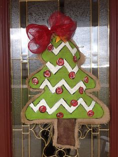 This door hanger is hand painted on natural burlap with acrylic paint. These color scheme is red and lime green and is the perfect door decoration for this Christmas season! Burlap door hangers are a beautiful alternative to the traditional Christmas wreath. Please convo me with any questions!  The item for sale is the lime green Christmas Tree shown in the first picture. This is made and ready to ship. These make GREAT Christmas gifts! It is 24 inches long and 18 inches wide at the widest…
