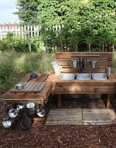 """(GP_5) Dramatic play kitchen implemented outdoors provides a variety of learning opportunities. Children may pretend they are at an outdoor patio restaurant or perhaps a backyard barbecue. This elevates the common """"kitchen"""" play to a whole other level. It also provides children an opportunity to get as messy as they'd like with minimal cleanup."""