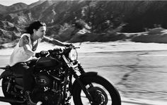 Chick riding HD Nightster through the hills.