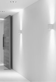 Pure lines and soft indirect lighting_GREAT DOORS AND WALL LIGHTING. Love the clean crisp white walls.