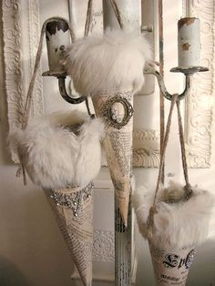 Elegant fur, antique book pages and vintage jewelry cones.