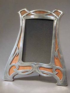 Polished pewter and wood Art Nouveau picture frame with original wood back   Country of Manufacture Germany  Date1906