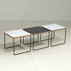 Pierre Guariche; Enameled Meta, Plywood And Laminate Occasional Tables for Steiner, 1950s.