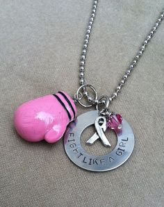 fight like a girl pink boxing glove necklace. $20.00, via Etsy.