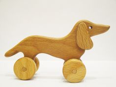 Wooden Rolling toy Sausage Dog Learning Wooden Pull Toy for toddlers Montessori Wood Toy Animals on wheels Gift for boys Christmas gift idea by WoodenCaterpillar on Etsy