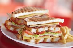 The Little Chef toasted club sandwich - Crispy chicken, bacon, cheese, tomato, salad and mayonnaise, served with skinny fries or regular chips.