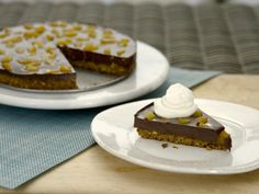 Get Chocolate-Pistachio Fudge Tart Recipe from Food Network use ginger snaps instead of graham crackers.  Can also use macadamia or hazelnuts. Can use any sweetener you like.  Read reviews before making.