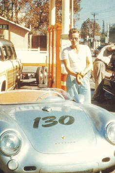 James Dean and his Porsche 550 Spyder this photo was taken just before he died . Last fill up !