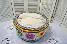 Crochet Cat Cave Pet Bed Upcycled Wicker Basket Granny Square Mulitcolor Boho Handmade Littlestsister  A crocheted cat cave pet bed upcycling a wicker basket! I covered the basket outside with multi-colored acrylic yarn using a variety of stitches for a really unique look! The cushion in polyfil and heavy cotton fabric and is washable. I think it needs a blanket to make it extra special, but am leaving the color choice up to you.  Unique home for your artsy kitty!  The bed measures about 8…
