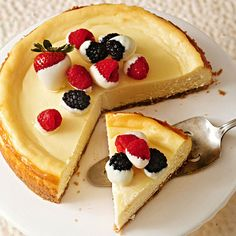 Forget milk chocolate! Make this White Chocolate Cheesecake with fresh fruit. More rich and creamy cheesecakes: http://www.bhg.com/recipes/desserts/cakes/cheesecake-recipes/creamy-cheesecake-recipes/?socsrc=bhgpin072713whitechocolate=2
