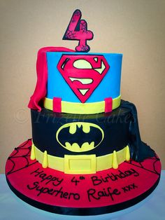 Superhero birthday cake for a 4 year old boy. Superman and batman. By Frizelle cakes Chichester in West Sussex.
