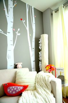 i like the gray walls/white mural with the pop of color from the accessories
