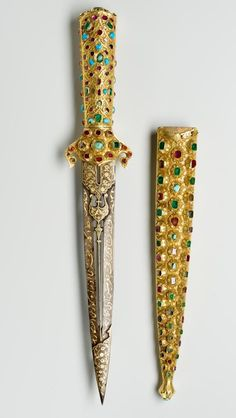 Ceremonial dagger - from Gábor Bethlen's collection. Date: second half of the 16th cent. -  early 17th century. Place of production: Turkey (Ottoman Empire) Istanbul (Constantinople). Materials: steel; silver-gilt; wood; ruby; emerald; turquoise. Techniques: chiselled; embossed; inlaid; chased; engraved. | Museum of Applied Arts, Budapest, ˆ 2015ˆˆ