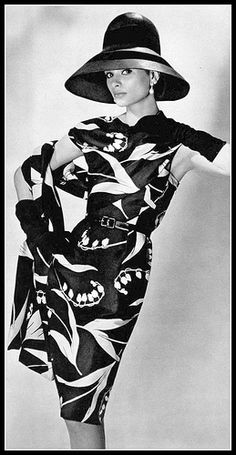 Model in black and white silk print (lily of the valley) dress, panel attached to bodice is used as stole, by Nina Ricci, photo by Georges Saad, 1963 | by skorver1