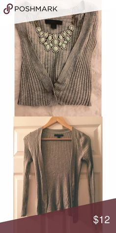 Grey Cardigan Adorable grey ribbed cardigan. Has many buttons so you have the option of wearing it open or closed. In excellent condition. [does not come with necklace shown in picture]. Express Sweaters Cardigans