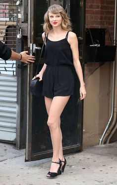 Taylor Swift style: black romper, heels, and red lips