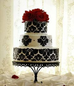 Gorgeous cake! These were the colors I originally wanted to do (black and white with red accents.) Really love the damask...