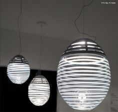 Artemide's Incalmo suspension lights are blown glass and very cool